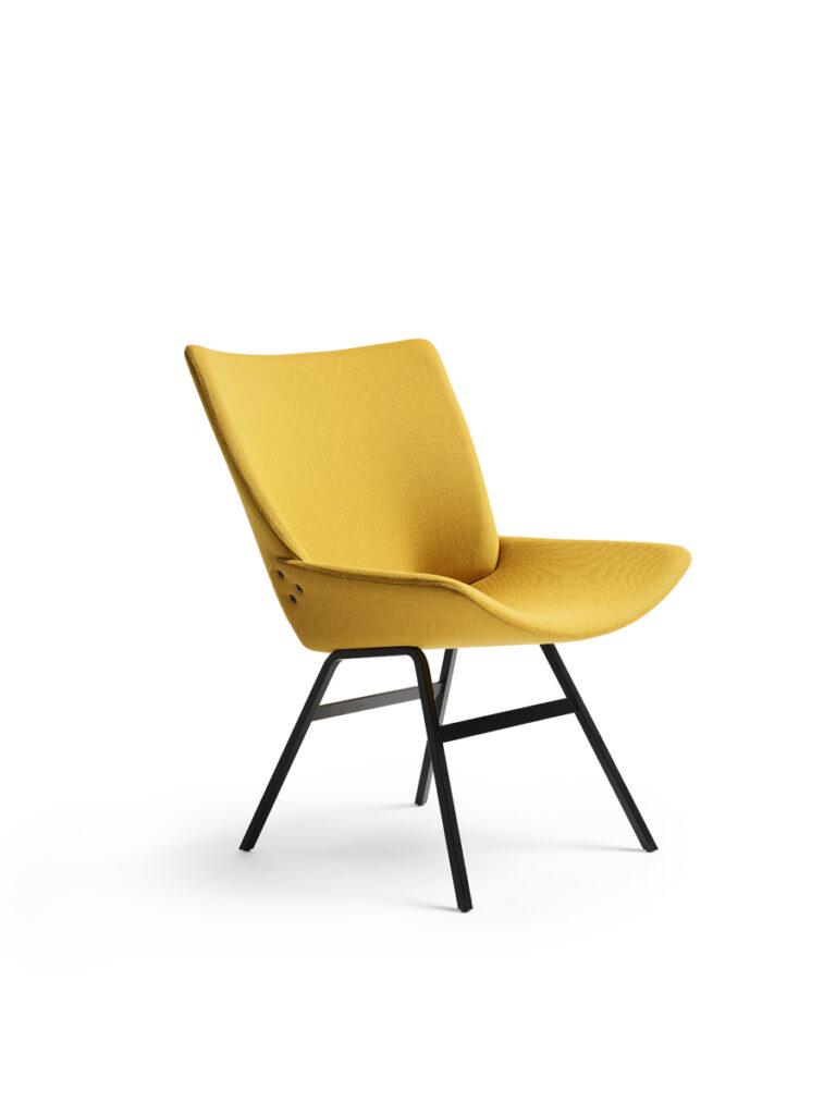 Shell lounge chair in full upholstery. Design by Niko Kralj.